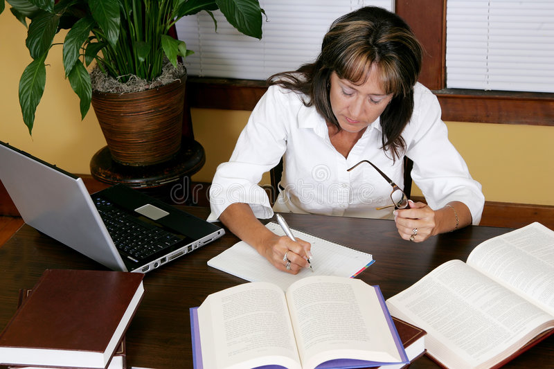 Woman researching and working royalty free stock images