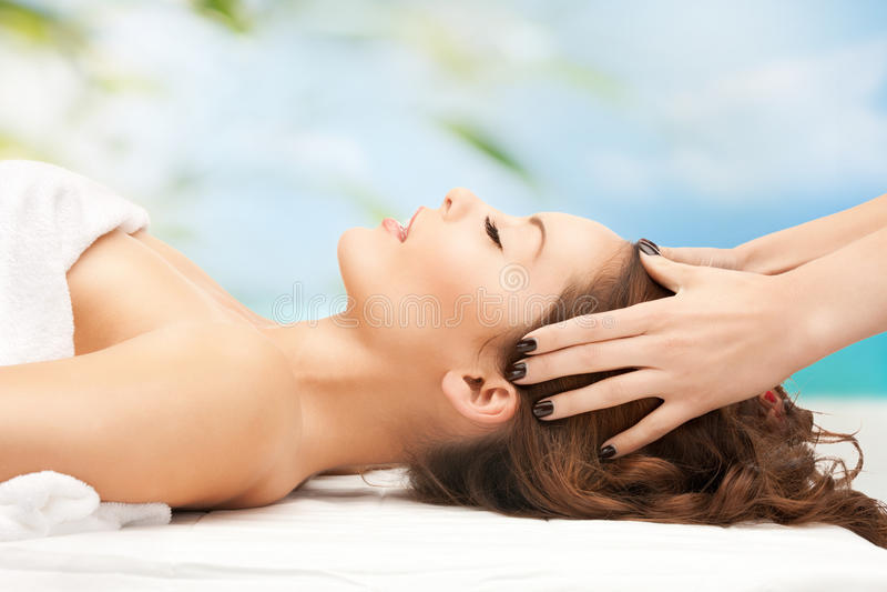 Woman on resort getting head spa treatment stock image