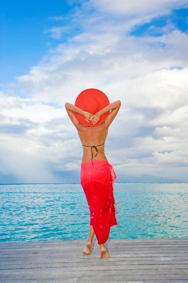 Woman resort red sarong royalty free stock image
