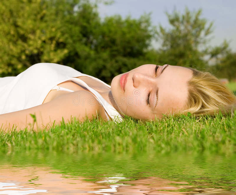 Woman Rest On The Green Grass Stock Photography