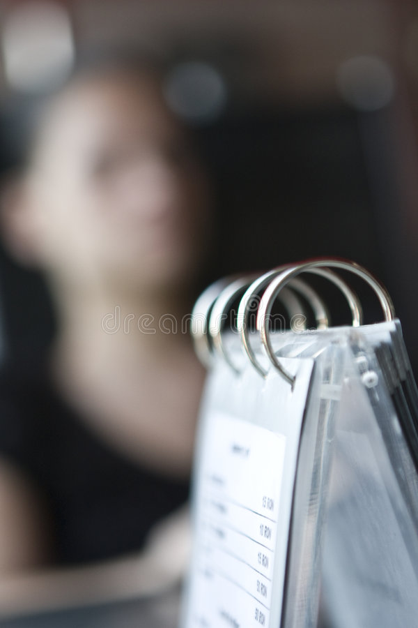 Woman and restaurant menu royalty free stock photos