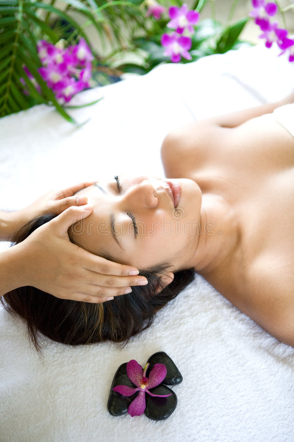 Woman restful while having a head massage stock image