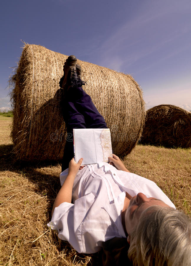 Free Woman Resting Against Summer Hay Bale Royalty Free Stock Images - 12474259