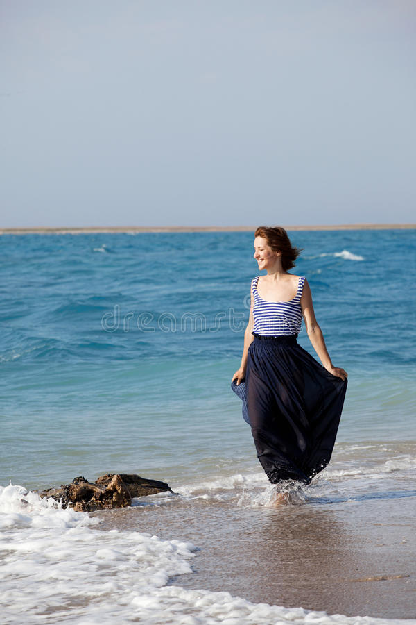 Woman resting on the beach in summer day stock photos