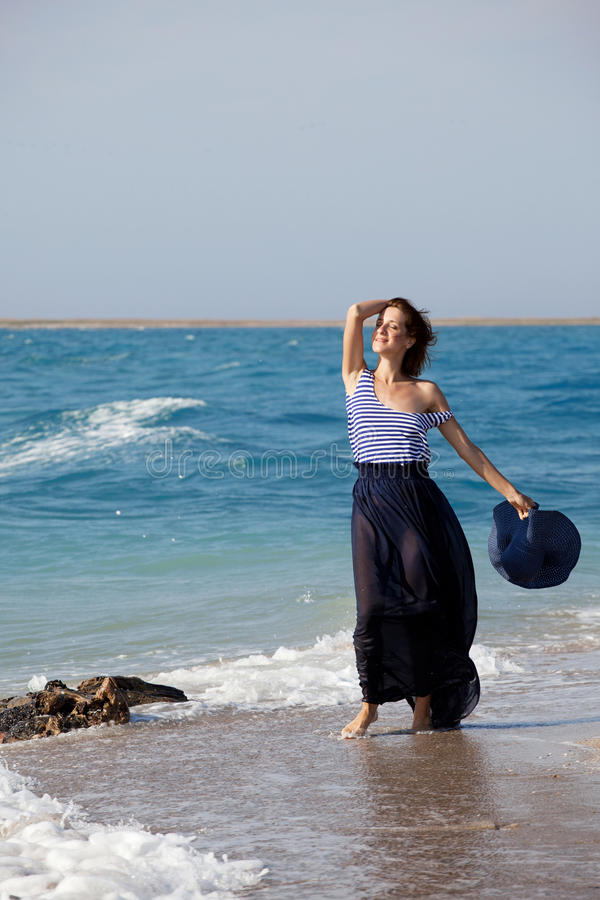 Woman resting on the beach in summer day royalty free stock image