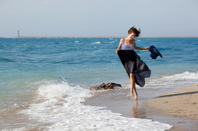 Woman resting on the beach in summer day stock photo