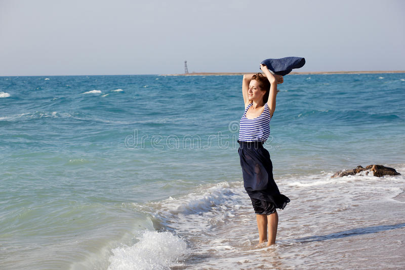 Woman resting on the beach in summer day stock images