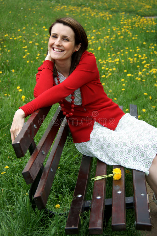 Woman resting on bench royalty free stock images