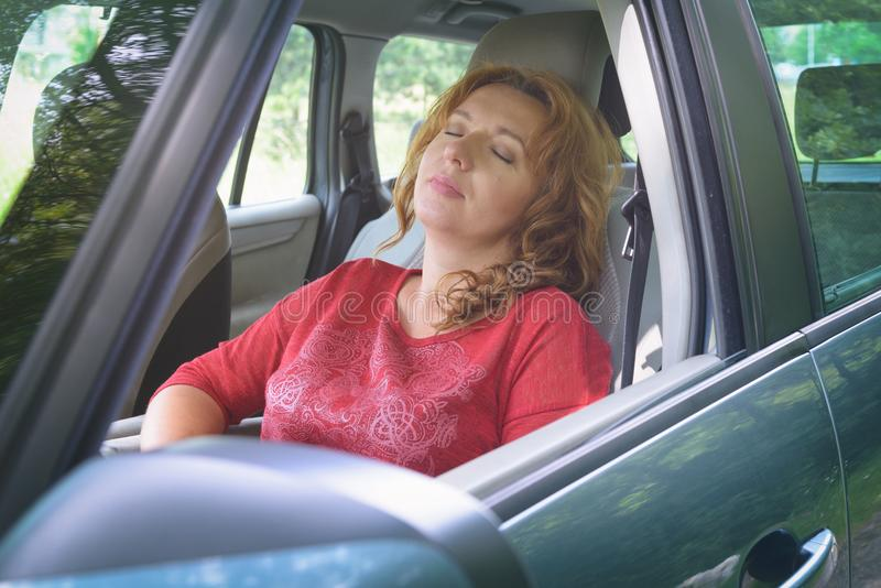 Woman is resting in the car royalty free stock photo