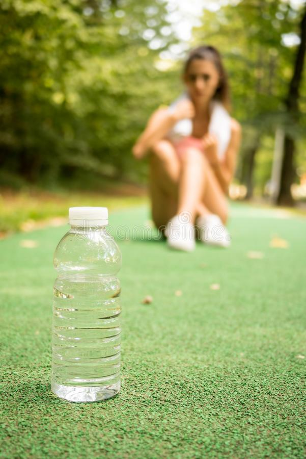 Woman resting after exercises outdoors stock images