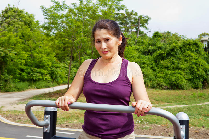 Woman Resting after Exercises Outdoors royalty free stock image