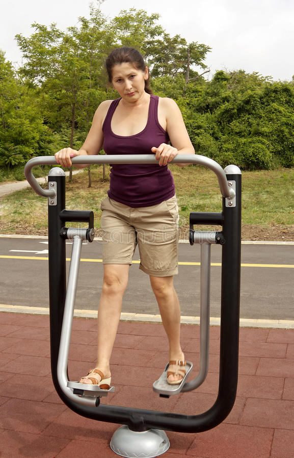 Woman Resting after Exercises Outdoors stock image