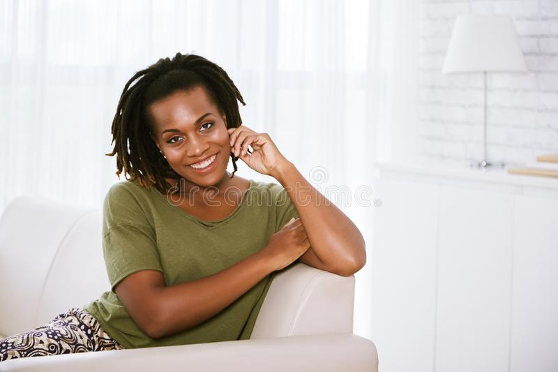 Woman resting on sofa stock photos