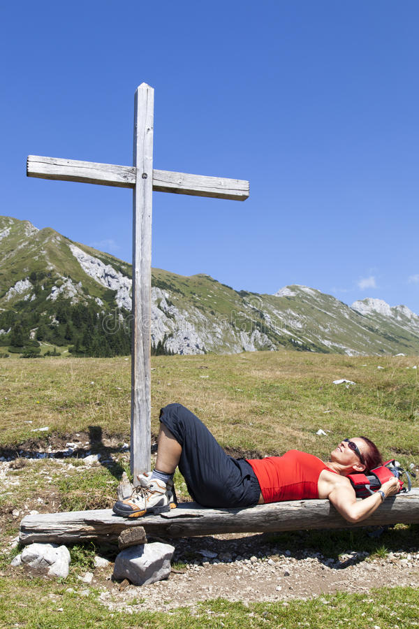 Download Woman Resting Under Wooden Cross Stock Image - Image: 33046453