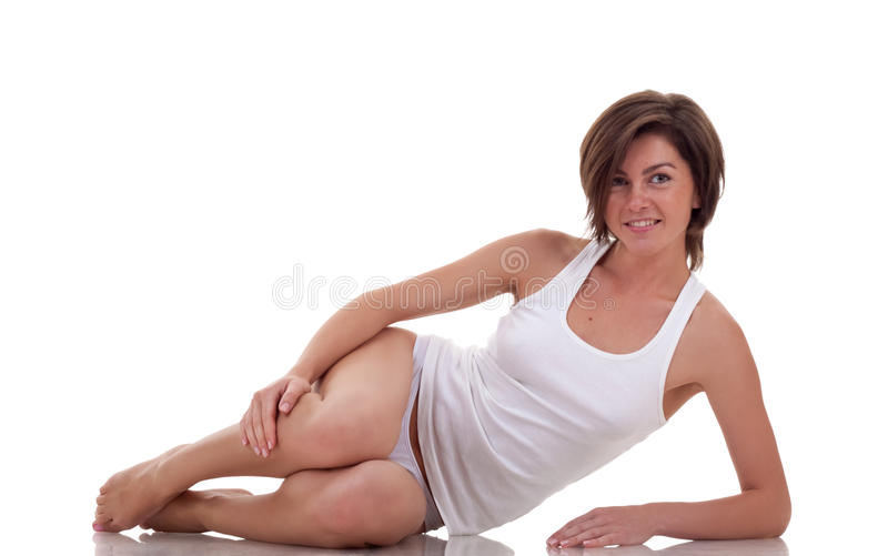 Woman resting after a workout. Beautiful young woman resting after a workout, over white stock images