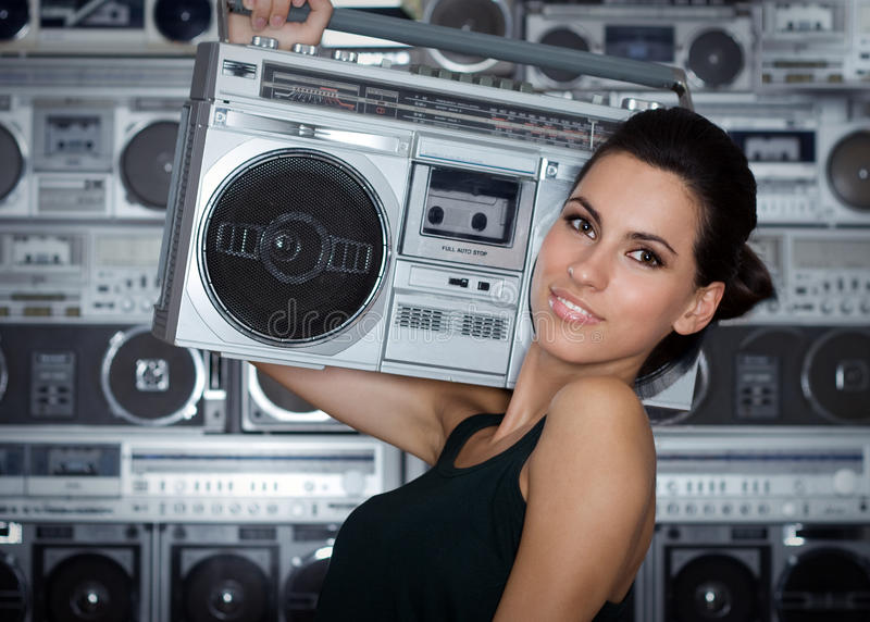 Woman with retro Boom Box. Beautiful woman with retro Boom Box royalty free stock photography