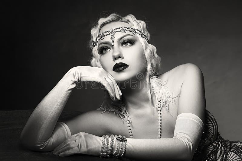 Woman retro flapper style. Beautiful woman retro flapper style woman black and white foto, roaring 20s royalty free stock photo