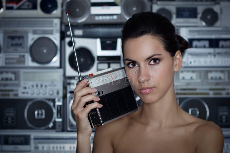 Woman with retro radio and Boom Box. Beautiful woman with retro radio Boom Box stock photo