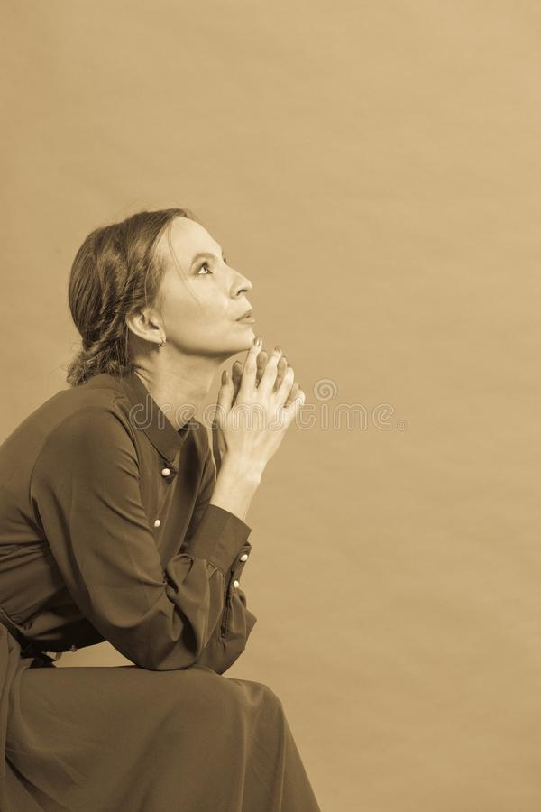Thoughtful woman retro style, sepia tone stock photos