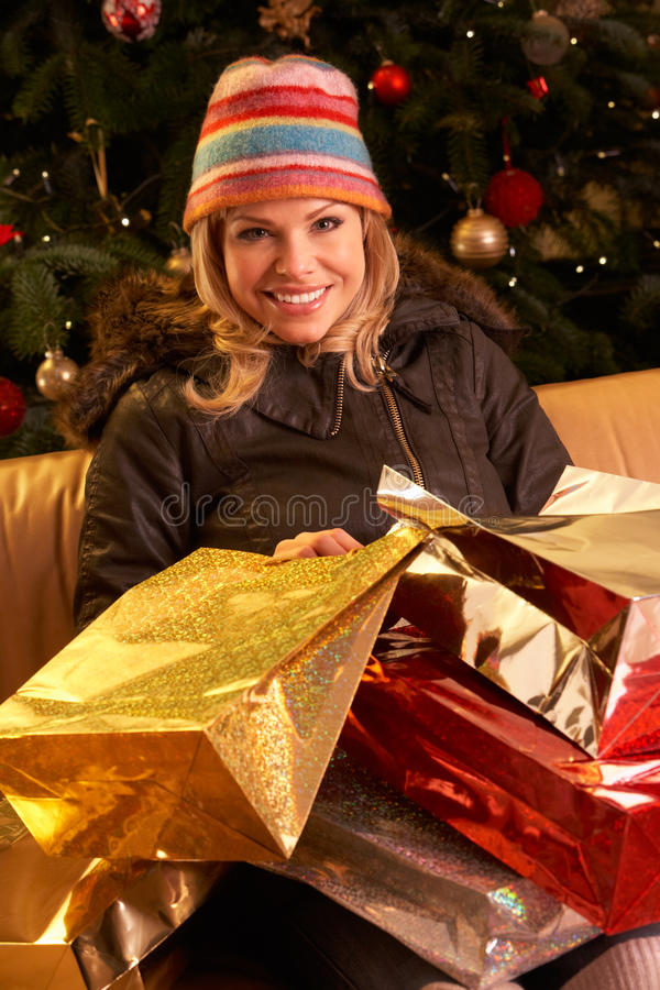 Woman Returning After Christmas Shopping Trip stock photography