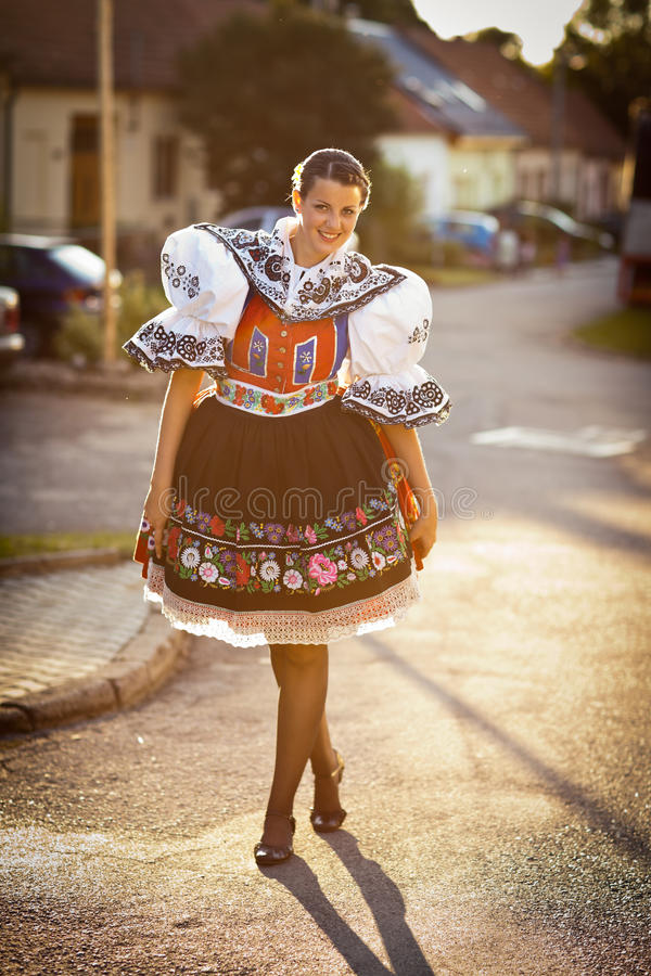 Woman in a richly decorated ceremonial folk dress. Keeping tradition alive: young woman in a richly decorated ceremonial folk dress/regional costume (Kyjov folk royalty free stock photos