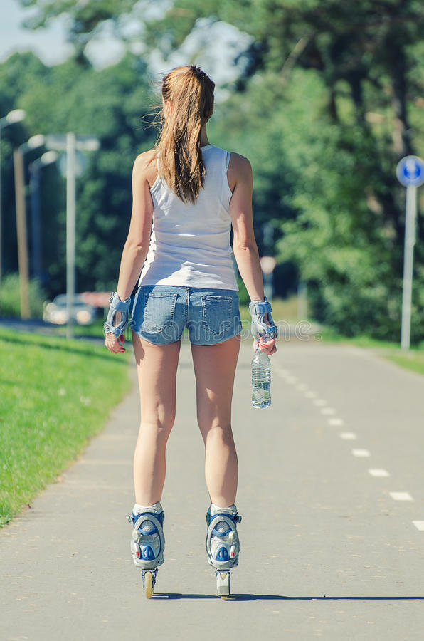 Download Woman Ride Rollerblades In The Park. Back View. Stock Image - Image: 33268331