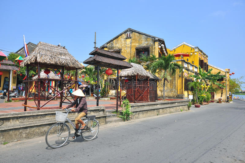 Woman rides a bike in Vietnam stock photos