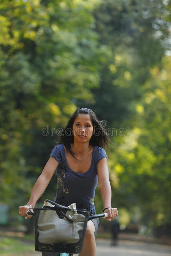 Woman Riding A Bicycle Royalty Free Stock Photo