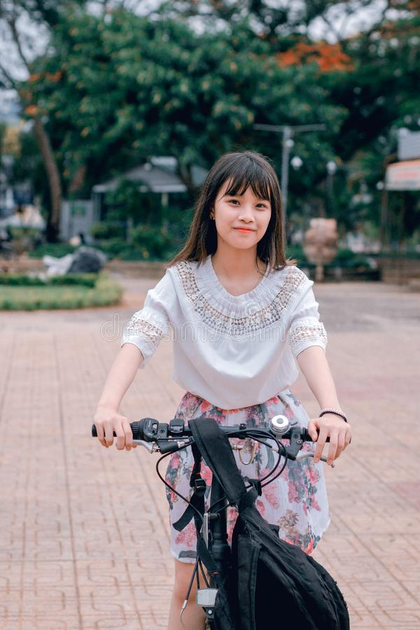 Woman Riding Bicycle stock photography