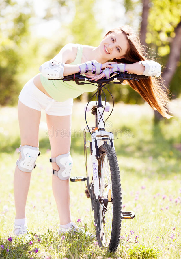 Woman Riding A Bicycle Royalty Free Stock Photos