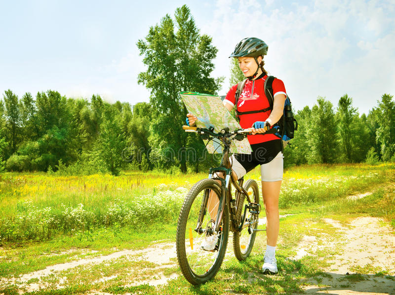 Woman riding bicycle. Happy young woman riding bicycle outside royalty free stock image