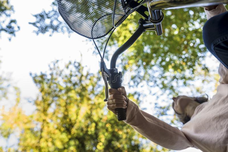 Woman riding a bicycle viewed from below royalty free stock photos