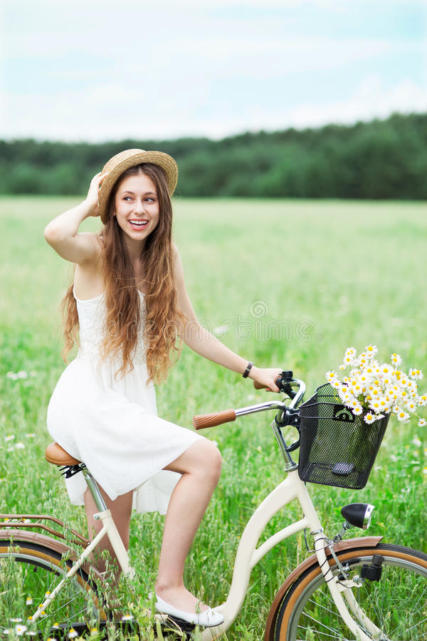Download Woman Riding Bicycle In Wildflower Field Stock Image - Image: 25864623