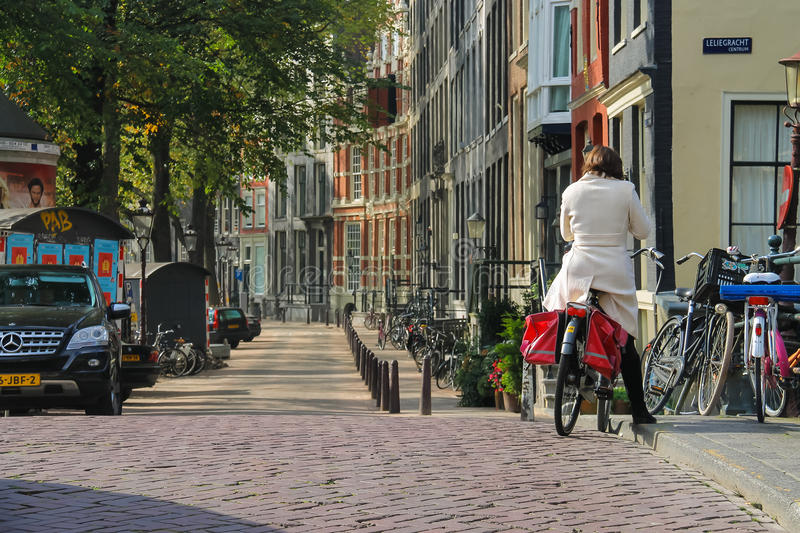 Woman riding a bike in Amsterdam, the Netherlands royalty free stock photo