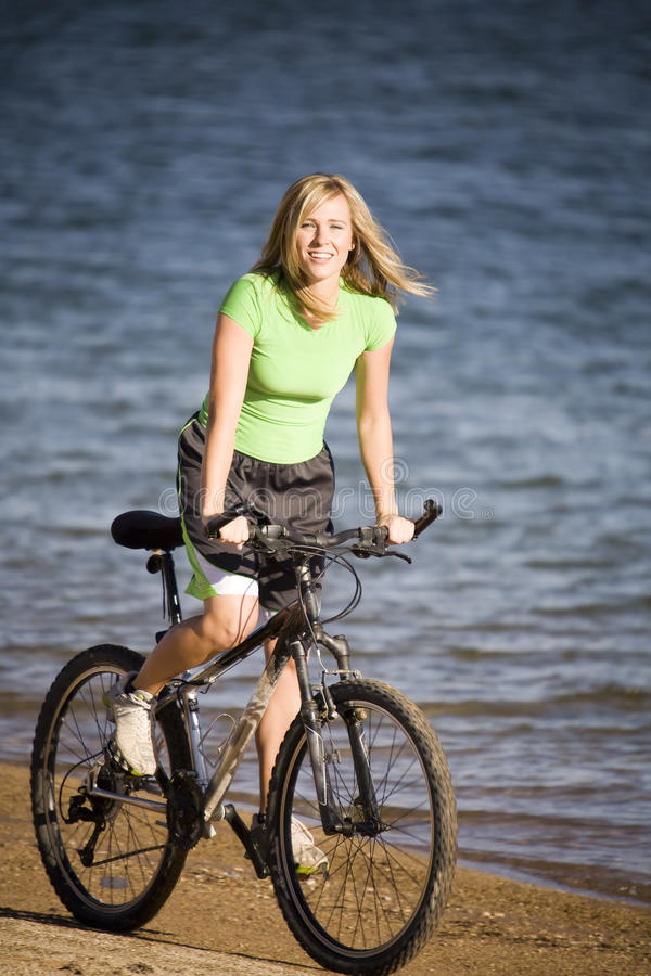 Download Woman riding bike on beach stock image. Image of female - 11518147