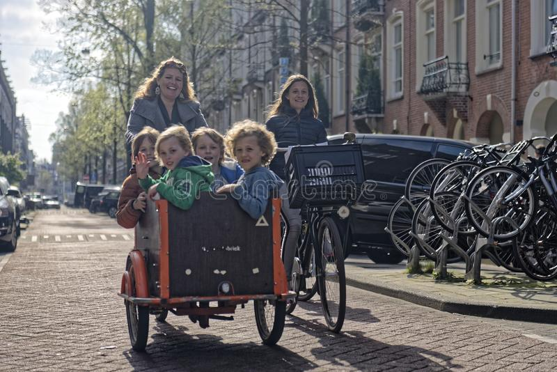 Family on bicycles in Amsterdam royalty free stock photos