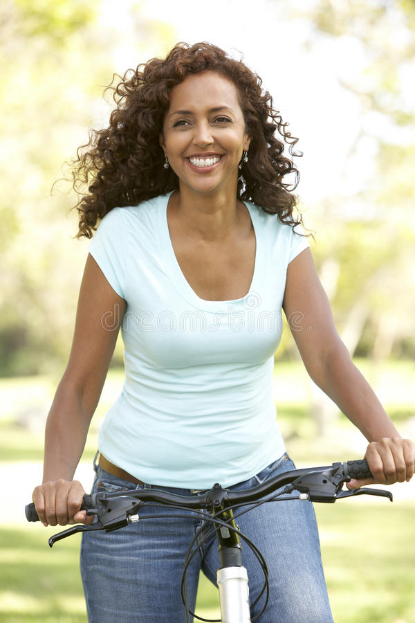 Woman Riding Bike In Park Stock Images
