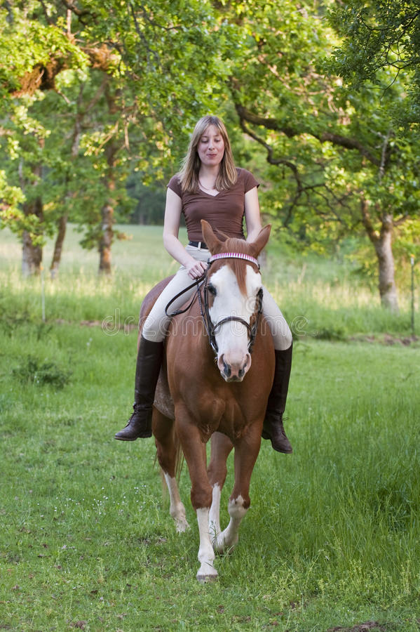 Woman riding her horse bareback. Pretty woman riding her horse bareback stock image
