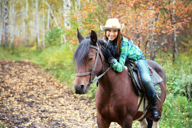 Woman riding a horse stock image