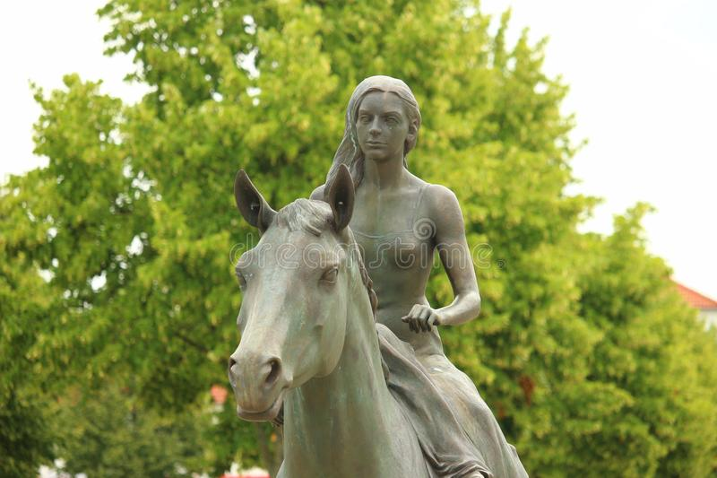 Woman Riding Horse Statue royalty free stock image