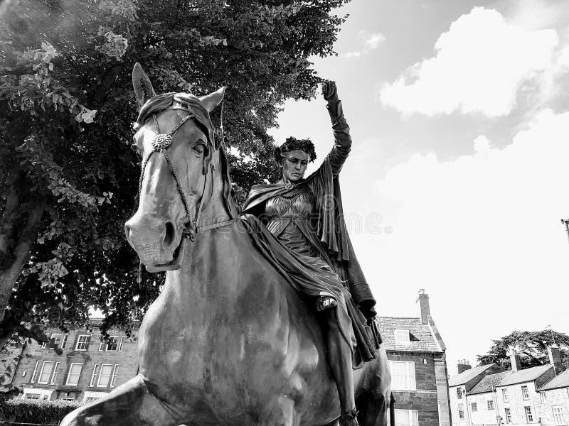 Woman Riding Horse Statue stock photo