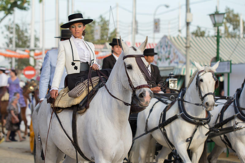 Woman riding horses in Sevilla feria de abril royalty free stock images