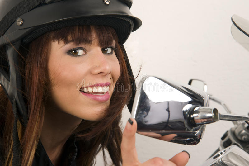 Download Woman Adjusts Mirror Motorcycle Smile Chrome Stock Image - Image: 20962737