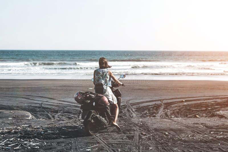 Woman Riding Motor Scooter on Seashore royalty free stock photos