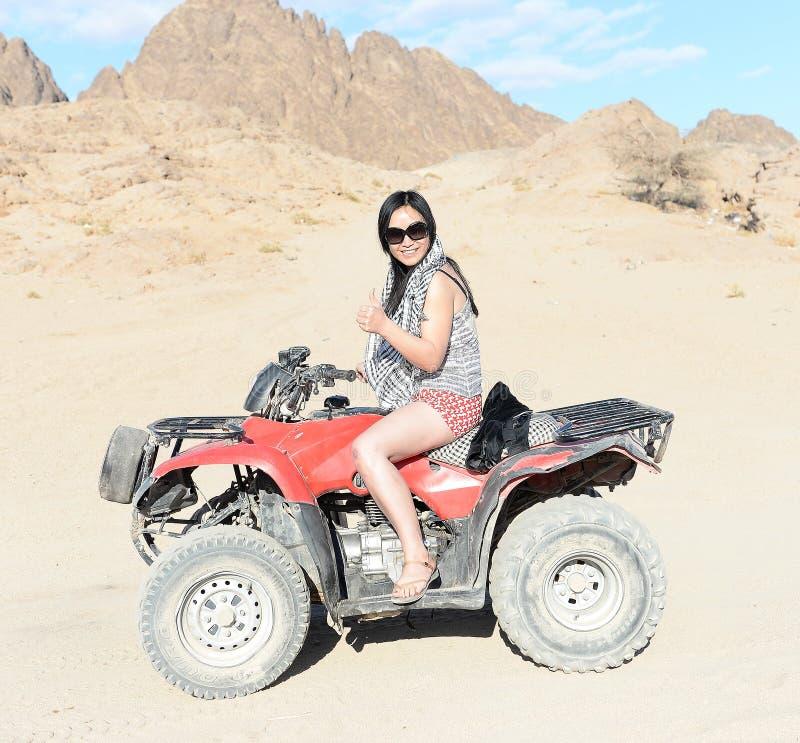 Woman riding a quad bike stock images