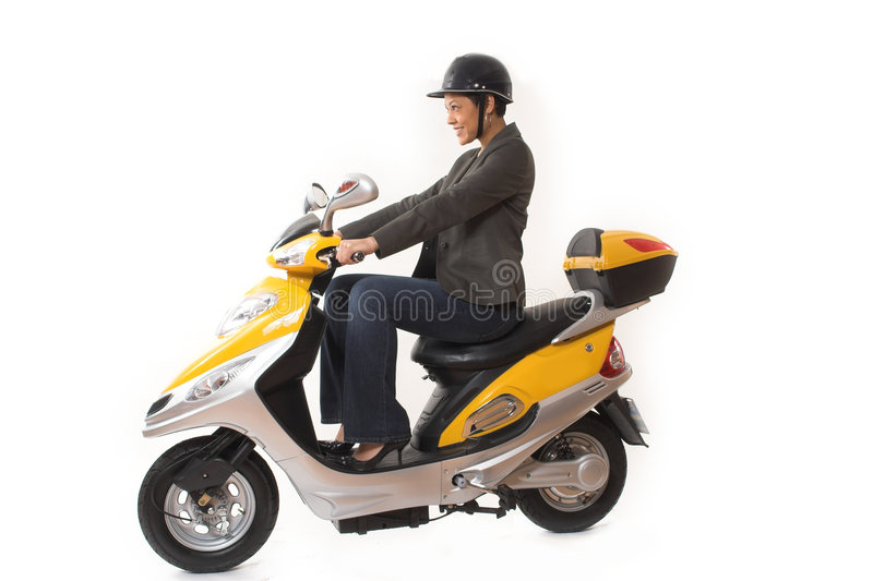 Woman riding scooter stock images