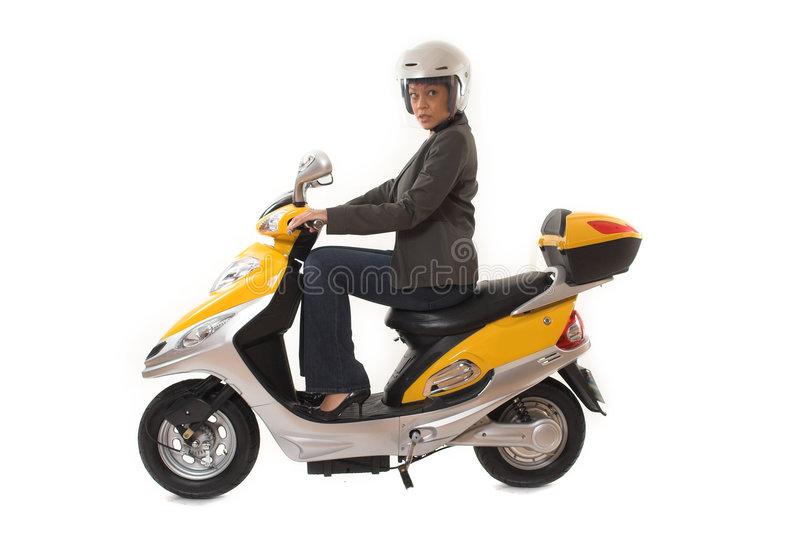 Woman riding scooter royalty free stock photo