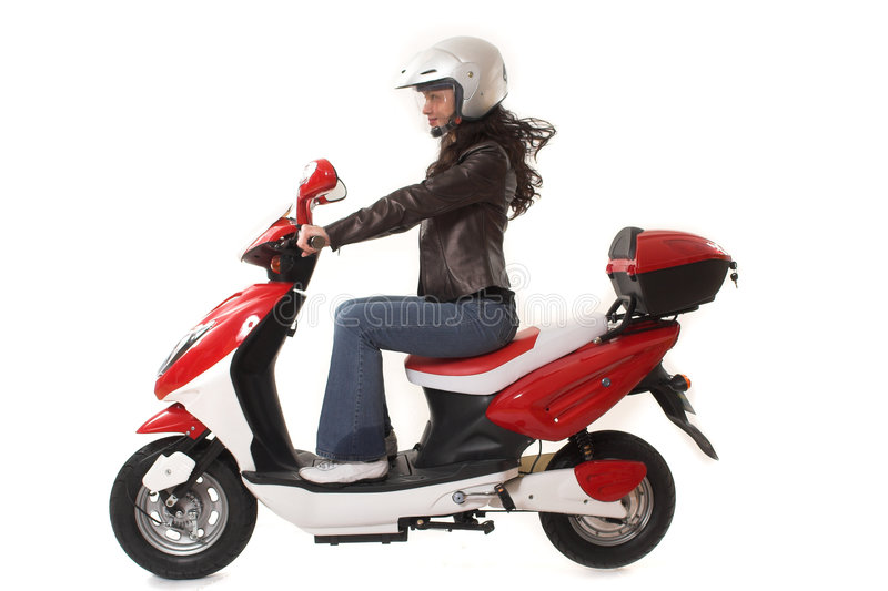 Woman riding scooter stock photography