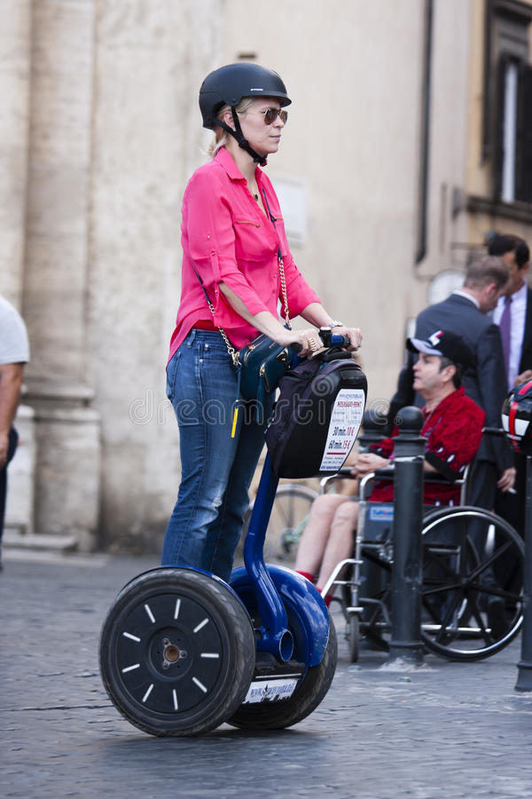 Woman riding segway stock image