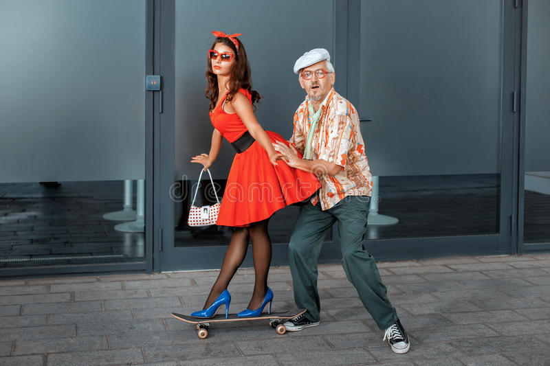 Woman riding on a skateboard. stock image
